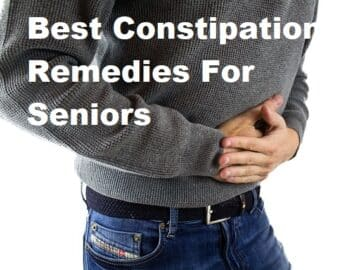 A man holding his stomach with the tite Best Constipation Remedies For Seniors